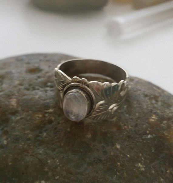Lovely sterling carved cut-out leaves with center oval moonstone in bezel setting