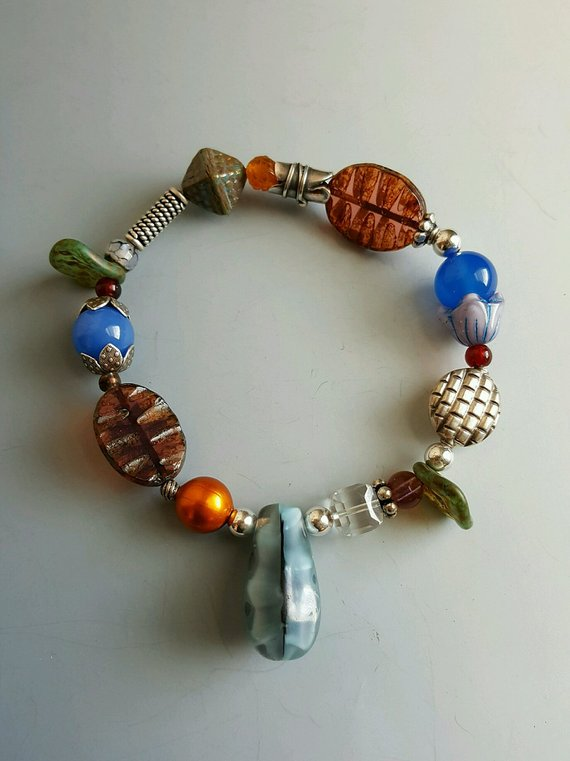 Multi stones and vintage glass, sterling beads, and vintage drop glass bead, on elastic