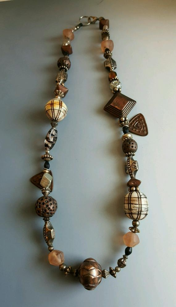 Brown beaded necklace from early collection. 15% off. Vintage glass, metal beads, textured beads, sterling beads