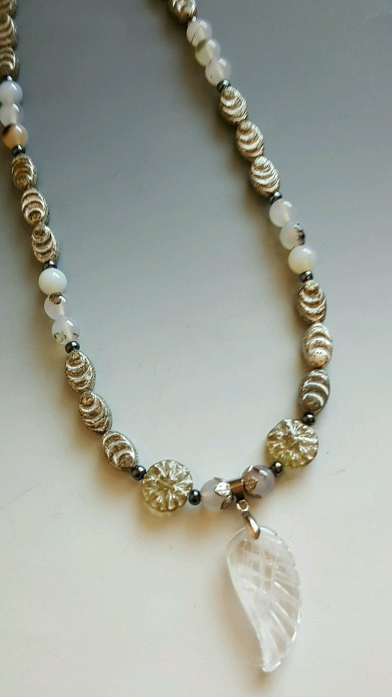 Lovely vintage silverish beads, Montana Agate beads, sterling bead caps, quartz carved angel wing drop, sterling chain and clasp