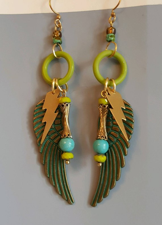 Wild and wonderful brass verdigris angel wings, hanging from green buna, brass lightening flass charms, turquoise beads, brass ear wires
