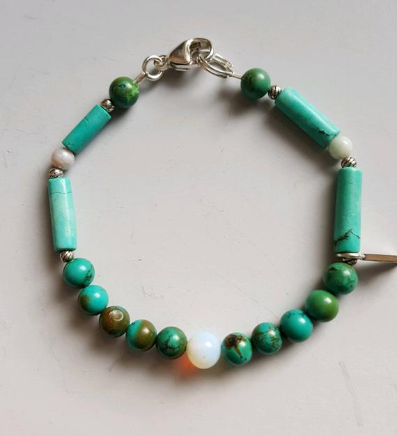 Multicolored turquoise beads and tubes, white agate beads, single sterling charm, sterling clasp