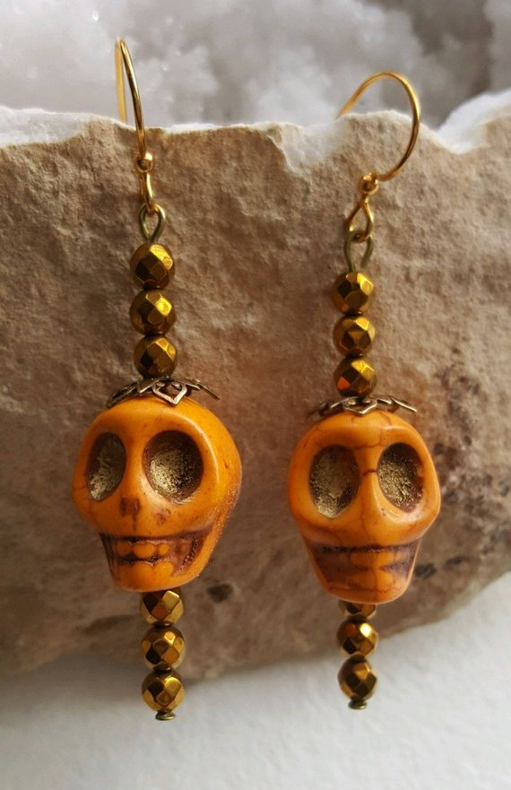 Orange Howlite carved skull earrings, faceted glass beads, Brass ear wires