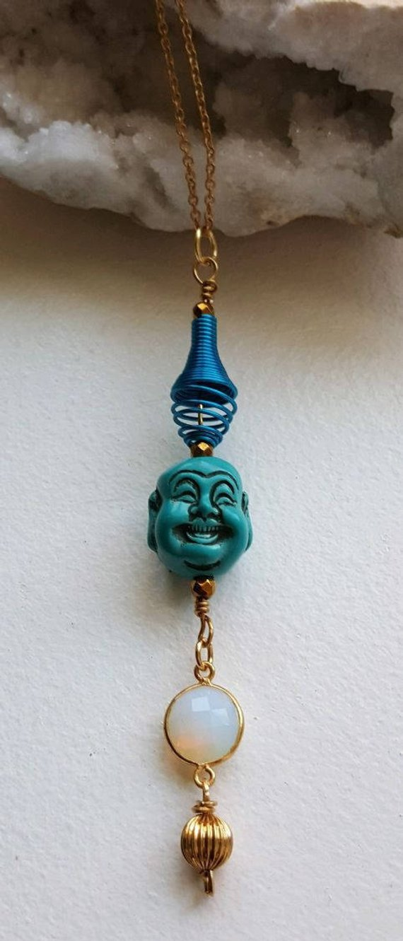 Blue Howlite double sided laughing Buddha, blue annodized aluminum swirl, faceted opalite connector, gold filled bead drop, raw brass chain