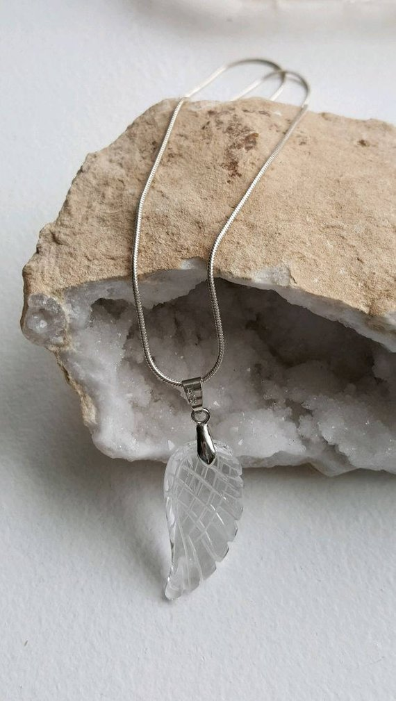 Beautiful Quartz Crystal carved Angel Wing pendant on sterling snake chain and clasp