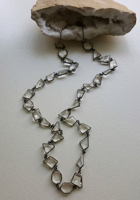 Long, over 30″ faceted quartz crystal, multi shaped beads, sterling frames and links, sterling back chain