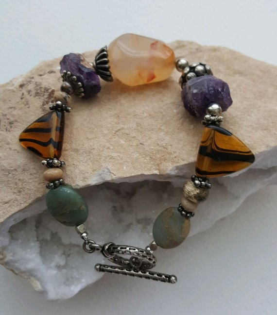 Large light color center agate, sterling beads, raw amethysts, tiger glass, green jasper, sterling toggle