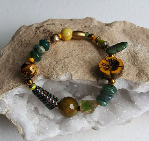 Multi stones, vintage glass, green agates, carved Tiger's Eye bead, gold plated Buddha, all on elastic for comfort