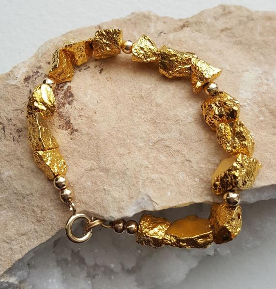 Stunning gold pyrite chunks, cold filled beads and clasp. 7.25″