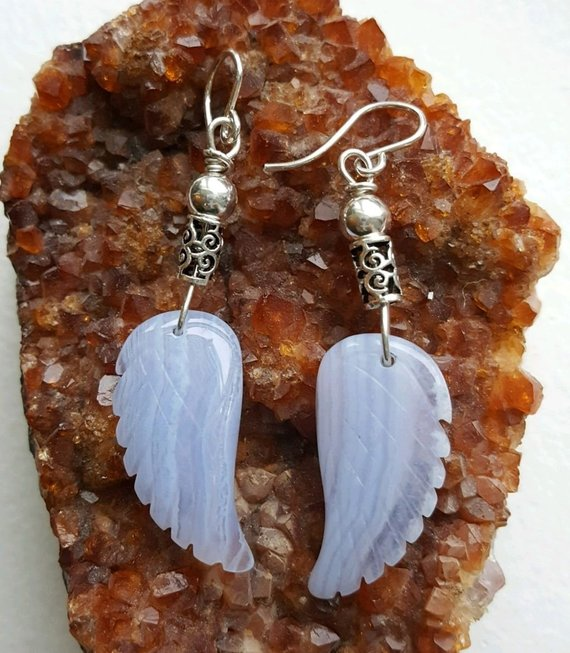 Add to Favorites image 0  Request a custom order and have something made just for you. This seller usually responds within 24 hours. Blue Lace Agate angel wings on sterling wire, sterling decorative beads, sterling French ear wires