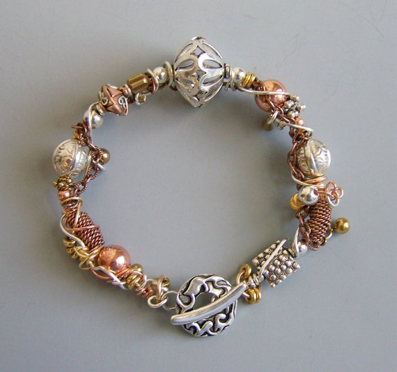 Made to Order. Mixed metals with sterling toggle clasp. Sterling wire wrapped