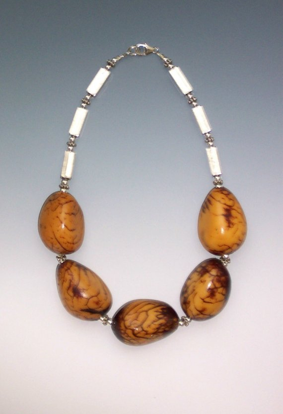 5 large pods, sterling tubes and beads/clasp