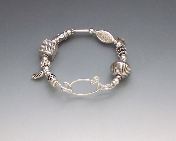 Many sterling beads on sterling wire, then shaped wire to form and main focus, and the clasp