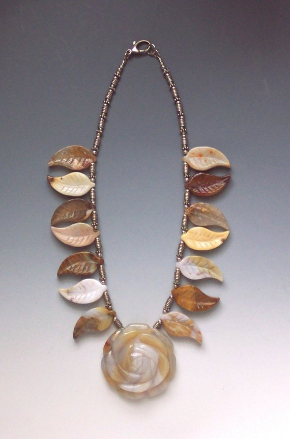 Carved center agate flower, side leaves and sterling beads and tubes, lobster