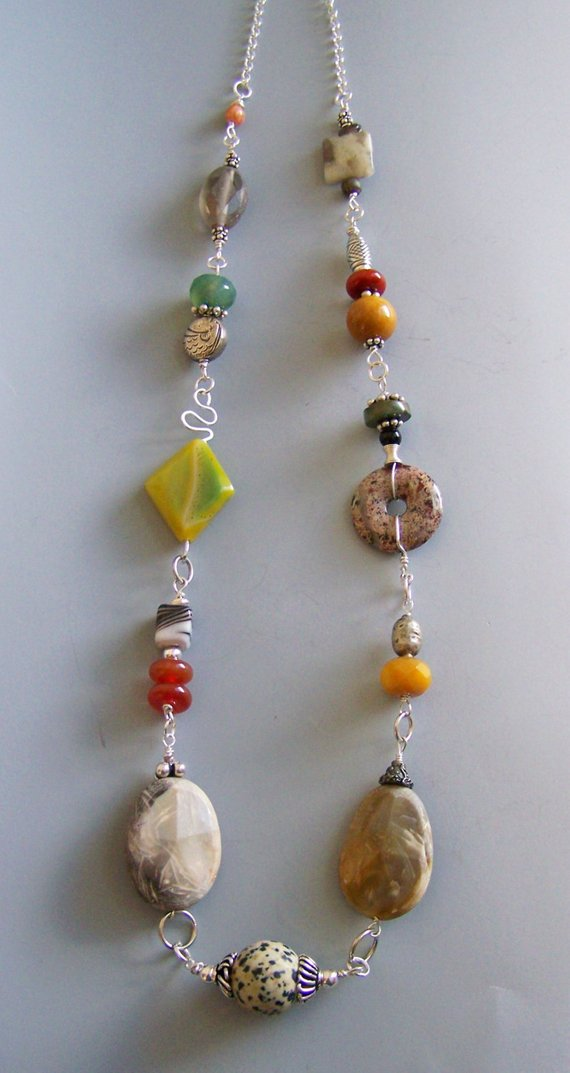 Many colors and shapes of Agates, on winding sterling wire, long and impressive