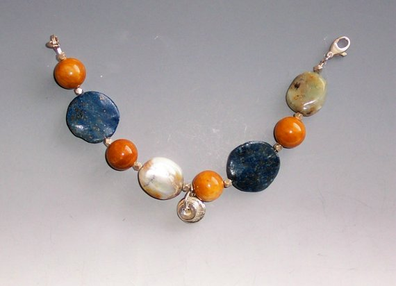 Very earthy agates, coin Lapis beads, orange agates and sterling beads, charm and clasp
