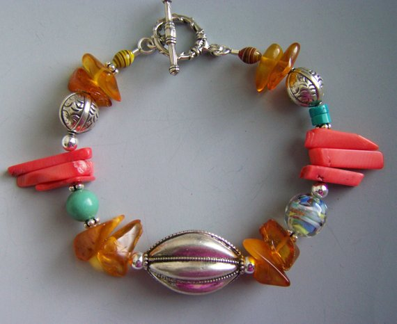Sterling center long pumpkin bead, amber, turquoise beads with coral beads and glass beads, sterling toggle