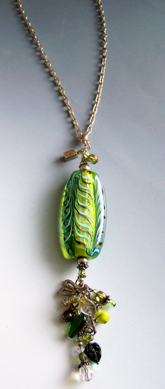 Hand blown green glass, charms and peridot and glass dangles above and below, on sterling chain