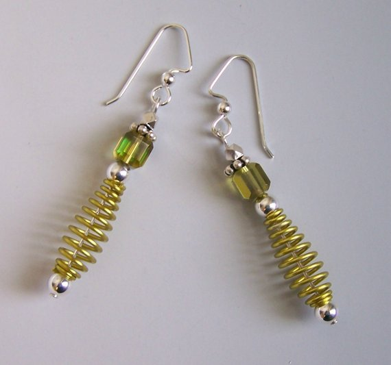 Swirl yellow annodized aluminum, green crystal, sterling beads and ear wires