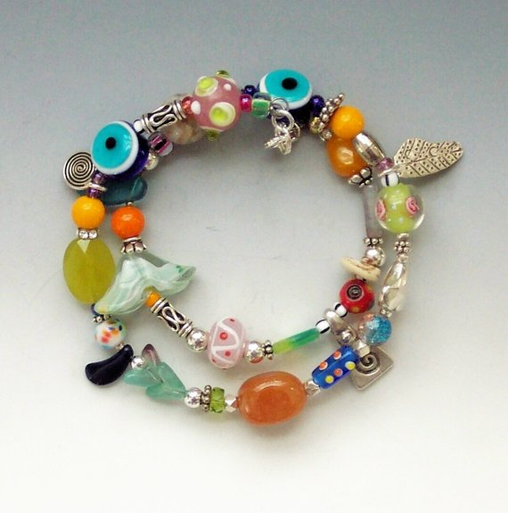 Snake bracelet on memory wire, 2 revolutions of colored class, stones, sterling charms