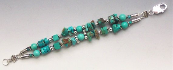 Double strand of Beautiful turquoise beads, sterling beads and large lobster clasp