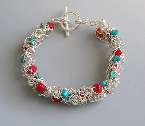 Made to Order, Sterling wire wrapped among coral and turquoise beads, to form a rounded bangle with toggle
