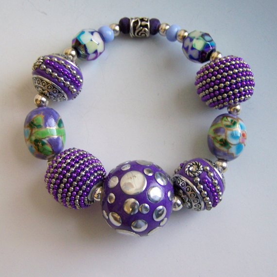 Fabulous purple beads of many eclectic materials, on elastic, for comfort