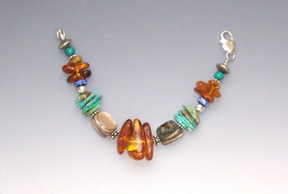 Wonderful combination of amber, abalone, turquoise, glass and sterling beads, 8″