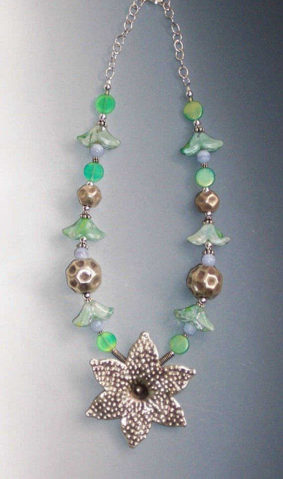 Thai Silver center large flower, glass flowers and irridescent beads, blue lace agates, sterling chain and lobster