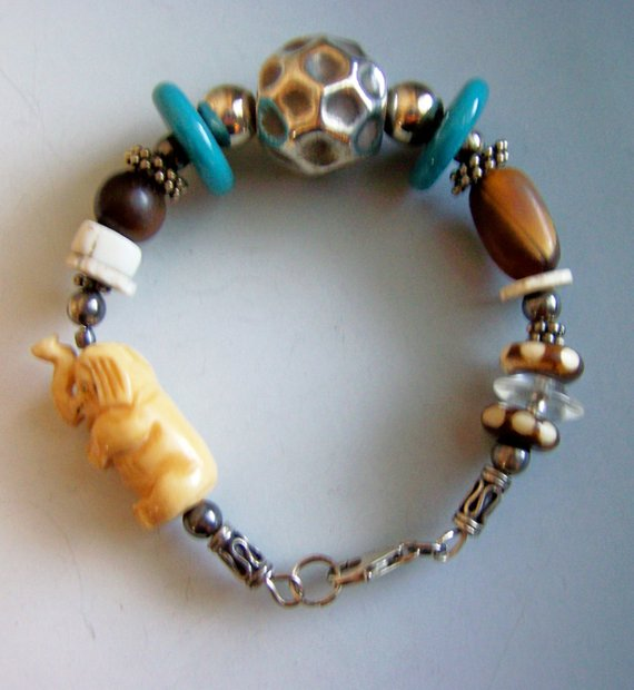 Price Adjustment! Beaded on sterling wire a large sterling ball, a bone carved elephant, blue ceramic and bone disk and lobster clasps