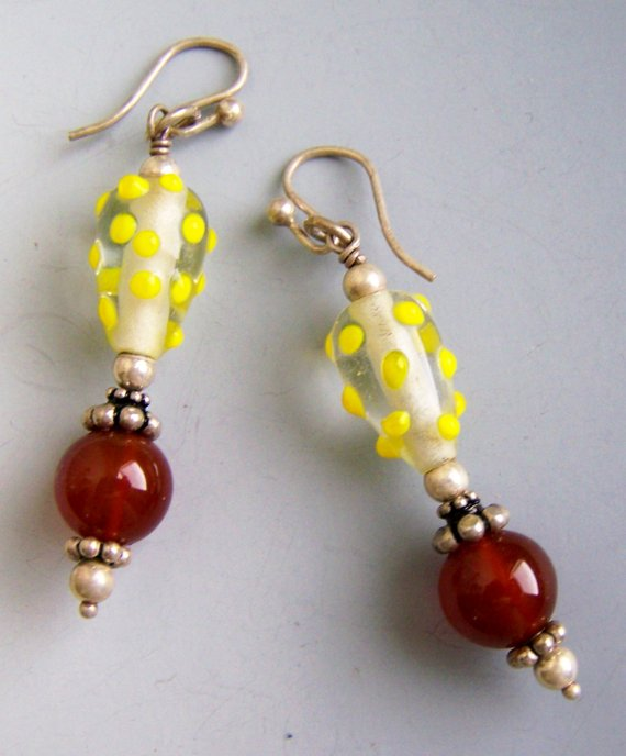 Fun yellow dot glass tops and beautiful carnelian beads with sterling findings on French wires