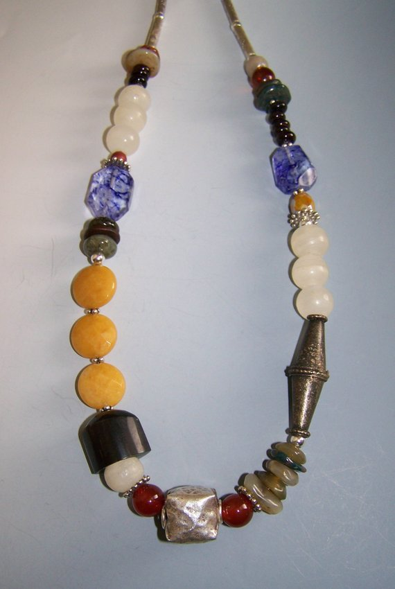 Center sterling pillow bead, carnelian, agates, quartz, labradorite beads, horn, metals, sterling tubes and chain