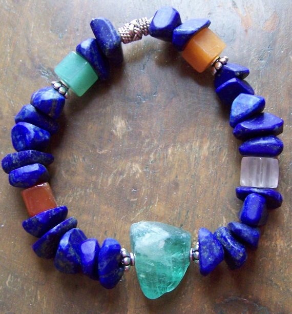 Bright blue Lapis chips with green Fluorite and semi-precious cubes, sterling beads; all on elastic to ease it on