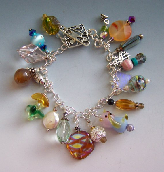 Multiple beads of agate, glass, pearl, sterling, shells, Sterling dollar sign charm, beautiful toggle with heart design