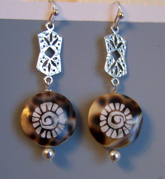 Add to Favorites image 0  Request a custom order and have something made just for you. This seller usually responds within 24 hours. Detailed hammered sterling upper earring, brown shell with design, sterling bead