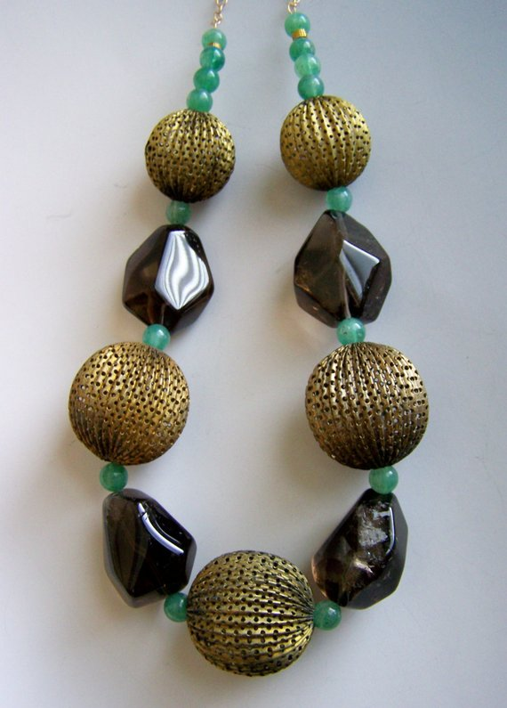 Large scale, short necklace, huge vintage brass dotted balls, faceted large smoky quartz, green stones separators. Brass chain