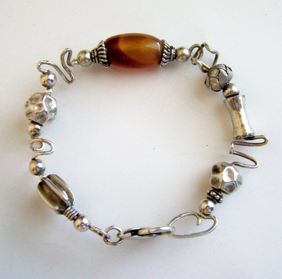 Sterling Wire free-form bracelet with center orange/brown oval agate, hand forged clasp