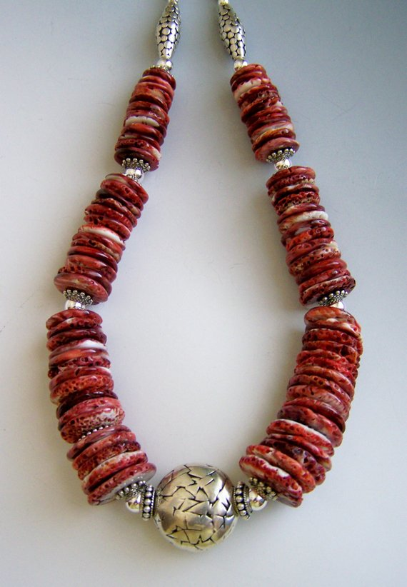 Large Spiny Oyster beads, large sterling carved center oval bead, other sterling beads and sterling chain and lobster