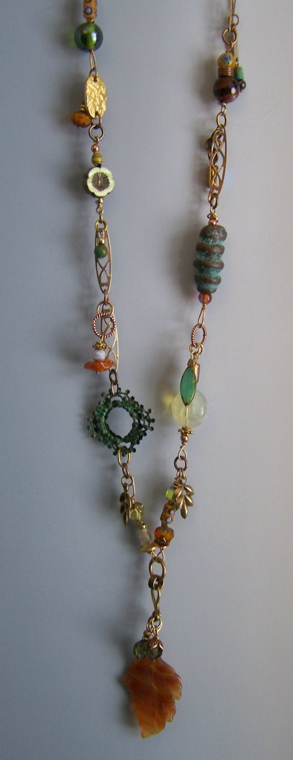 Mulitple brass findings and chain, glass and metal charms, colorful vintage beads, carved agate leaf drop