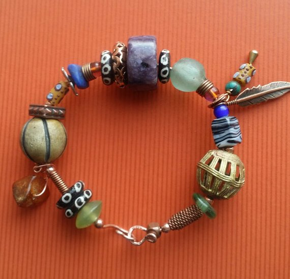 Multi-stones,Chaorite, batik bone, glass, brass, amber charms, copper feather charm on Copper Wire