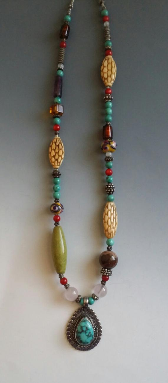 Turquoise-Sterling Teardrop pendant on beaded necklace