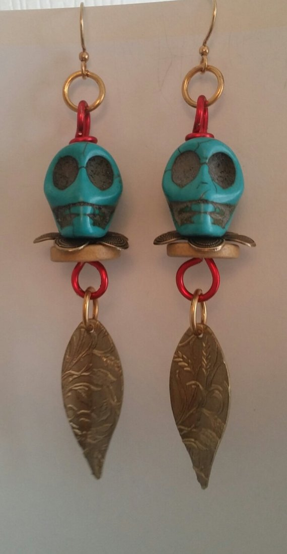 Blue Howlite Skulls on red aluminum wire, brass leaves