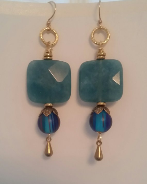 Dyed aquamarine faceted square bead, vintage brass bead caps, blue striped glass drop, and brass dangle