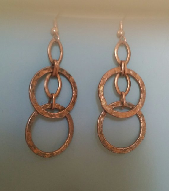 Copper hammered rings on Chain and wires