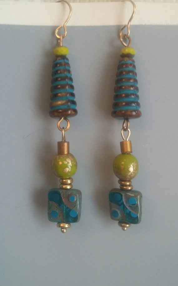 Blue swirls in Czech glass, green glass beads with gold, and square textured glass bead drops
