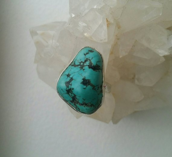 Chunky turquoise cabochon in sterling open setting, size 7