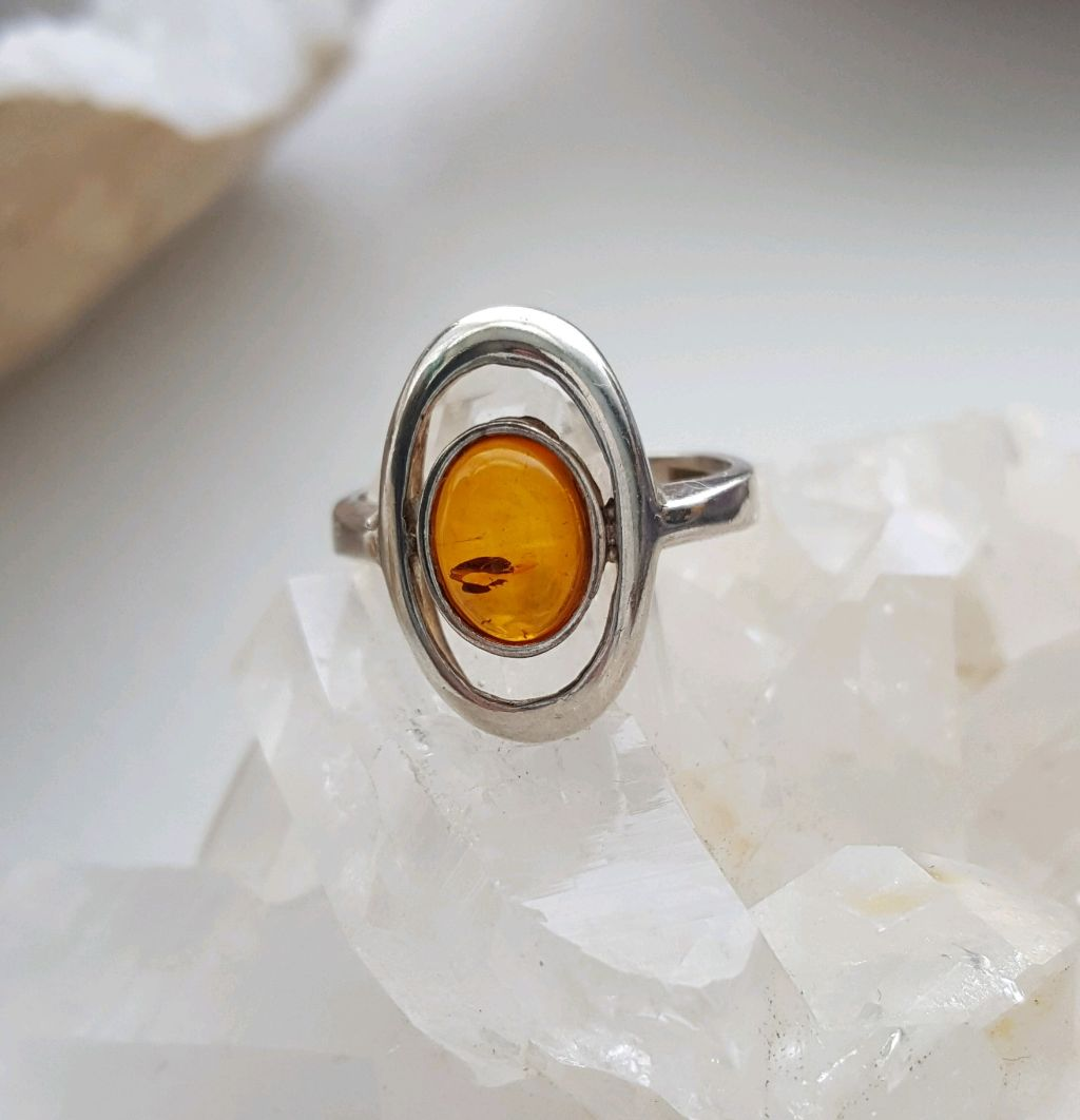 Oval Amber in oval sterling open setting, size 5.5