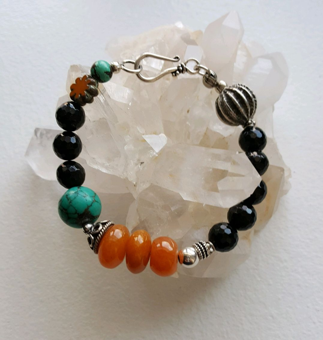 Black faceted Onyx beads, turquoise beads, orange agates, sterling beads and clasp