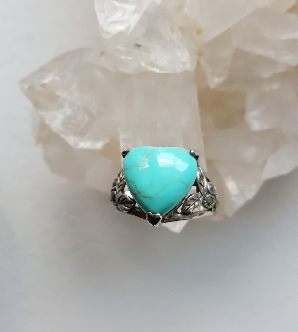 Turquoise composite puff heart in sterling floral setting