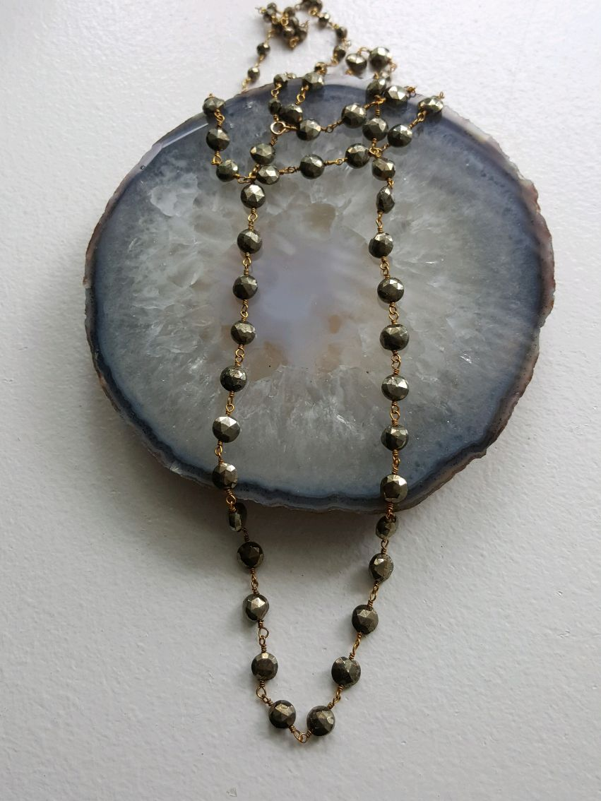 Long Pyrite rosary necklace, faceted beads on gold plated wire wrap